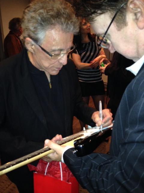 Frankie Valli autographs Fender Guitar