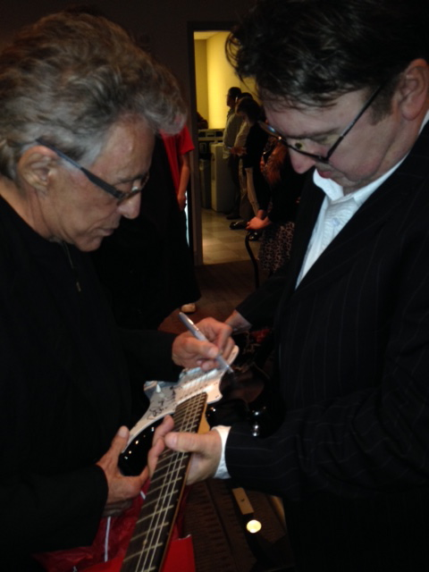 Frankie Valli Autographs Guitar for Benefit Concert