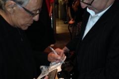 Frankie Valli Autographs Guitar for Benefit Concert